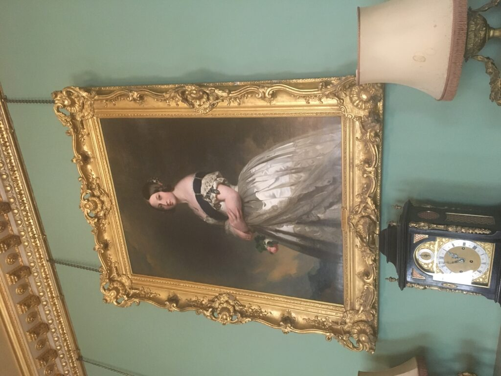 of the young Queen Victoria in an elaborate gilded frame